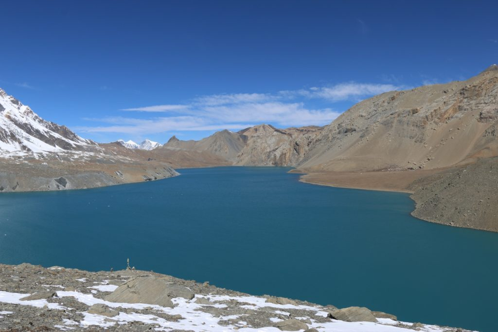 blue lake in the middle of the mountains